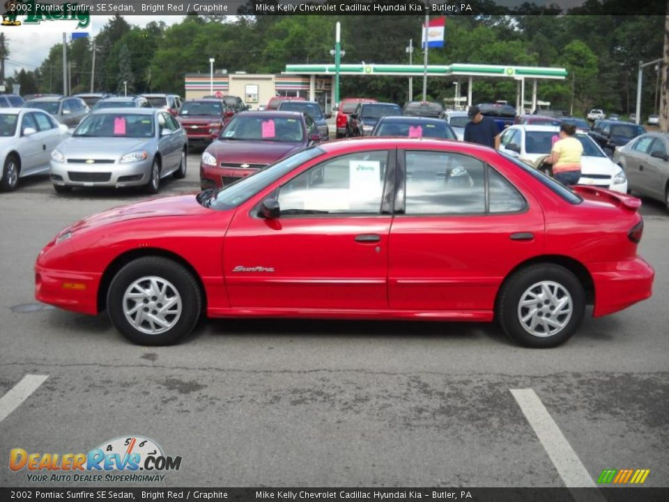 2002 pontiac sunfire se sedan bright red graphite photo. Black Bedroom Furniture Sets. Home Design Ideas