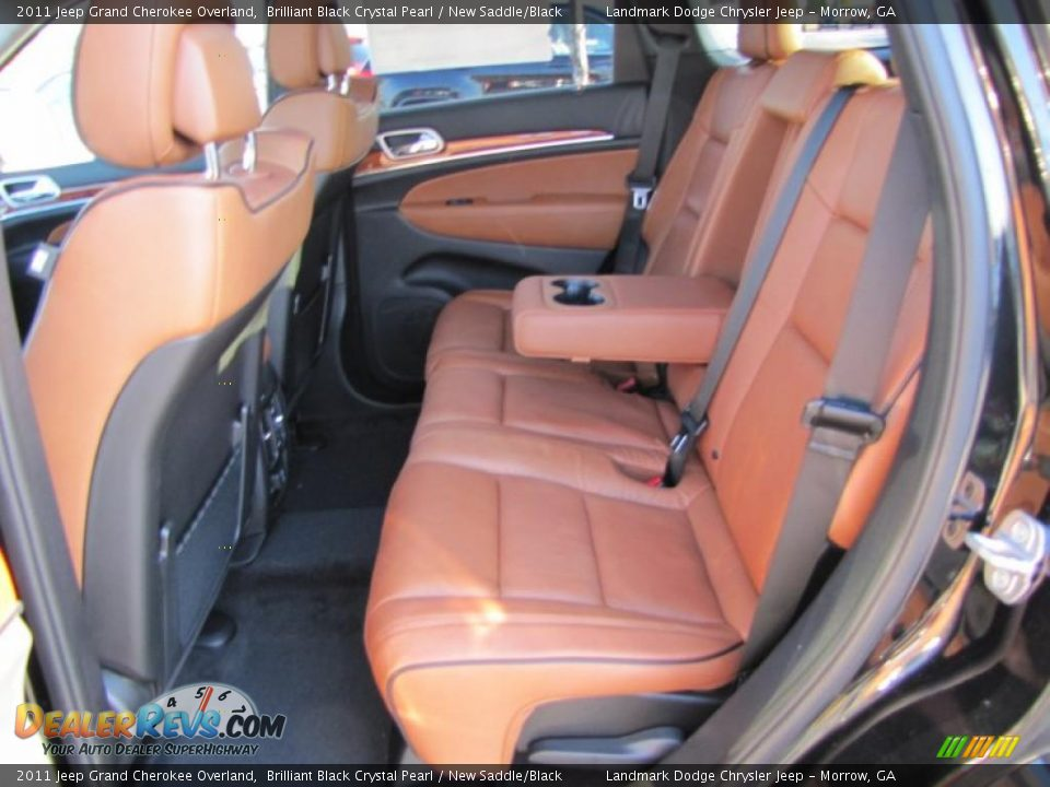 new saddle black interior 2011 jeep grand cherokee overland photo 7. Black Bedroom Furniture Sets. Home Design Ideas