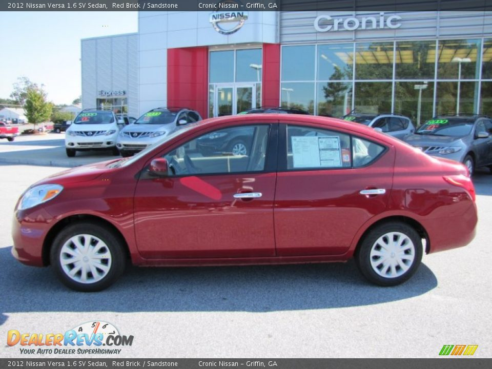 2012 nissan versa 1 6 sv sedan red brick sandstone photo 2. Black Bedroom Furniture Sets. Home Design Ideas