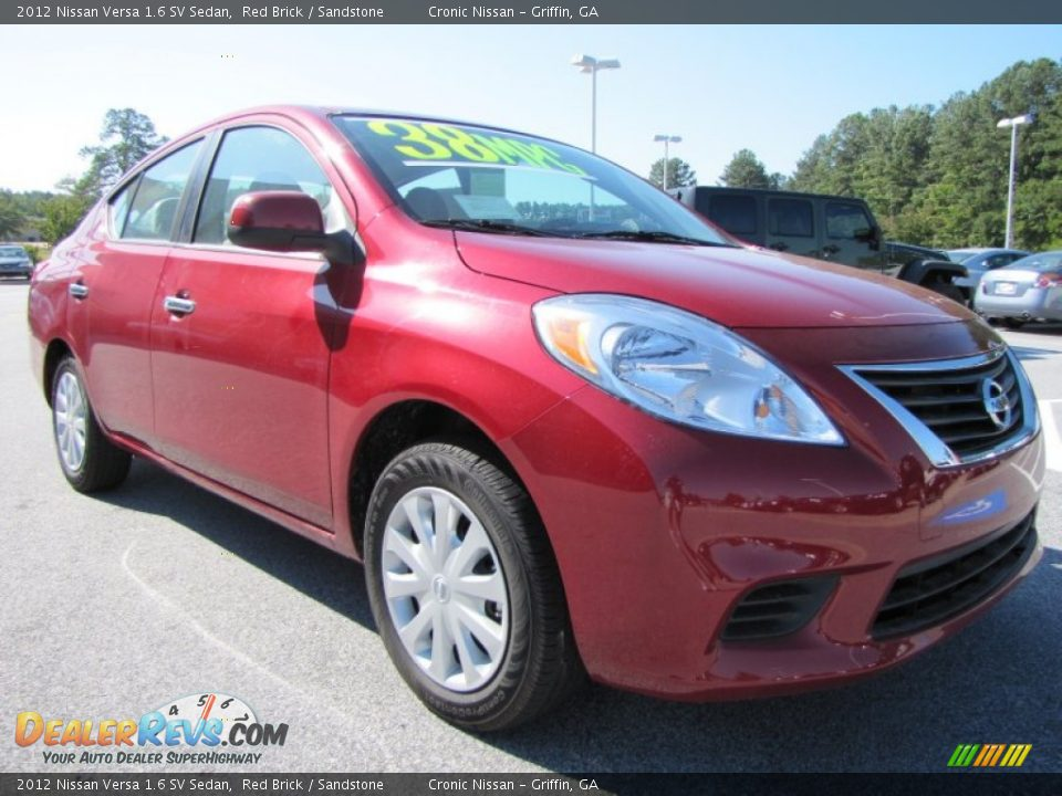 2012 nissan versa 1 6 sv sedan red brick sandstone photo 7. Black Bedroom Furniture Sets. Home Design Ideas