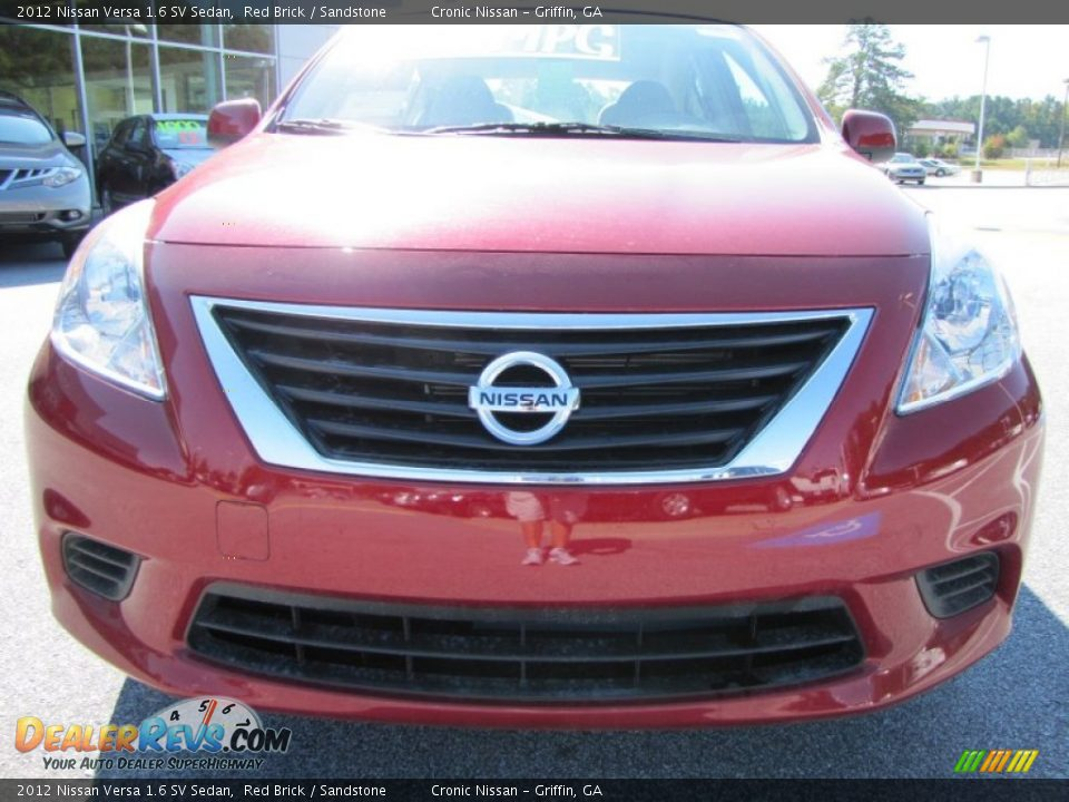 2012 nissan versa 1 6 sv sedan red brick sandstone photo 8. Black Bedroom Furniture Sets. Home Design Ideas