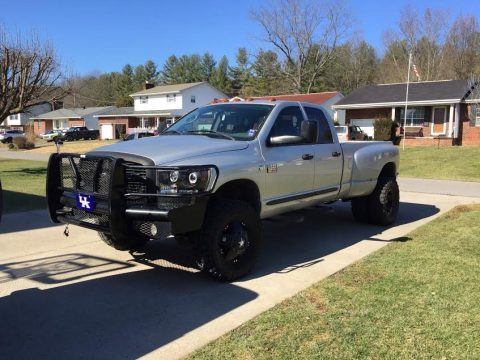 Bright Silver Metallic Dodge Ram 3500 ST Quad Cab 4x4 Dually.  Click to enlarge.