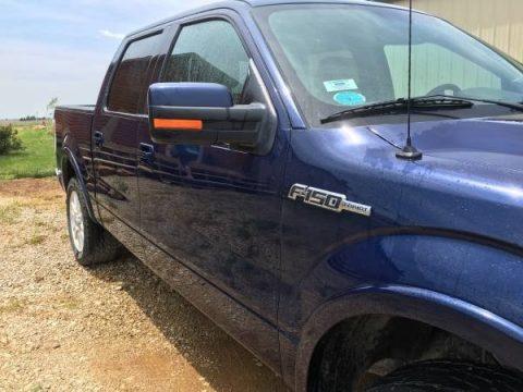 Dark Blue Pearl Metallic Ford F150 Lariat SuperCrew 4x4.  Click to enlarge.