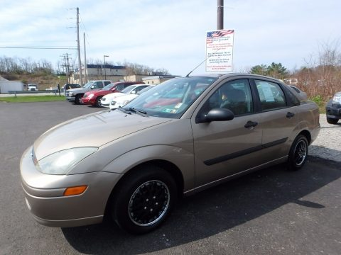 Arizona Beige Metallic Ford Focus LX Sedan.  Click to enlarge.