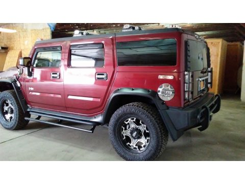 Red Metallic Hummer H2 SUV.  Click to enlarge.