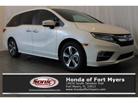 White Diamond Pearl Honda Odyssey Touring.  Click to enlarge.