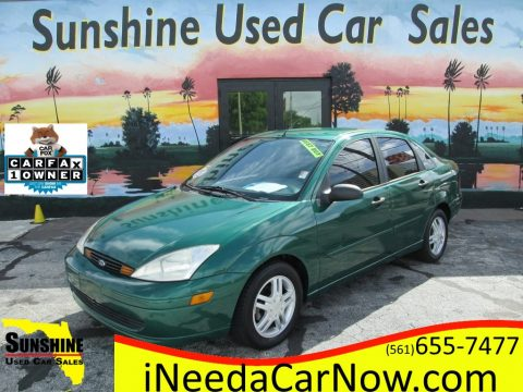 Grabber Green Metallic Ford Focus SE Sedan.  Click to enlarge.