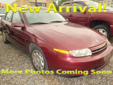 Dark Red Saturn L Series L200 Sedan.  Click to enlarge.