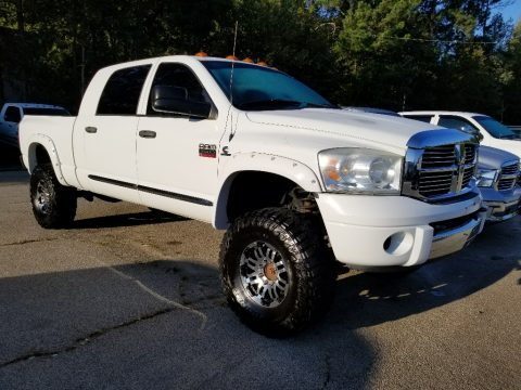 Bright White Dodge Ram 2500 Laramie Mega Cab 4x4.  Click to enlarge.