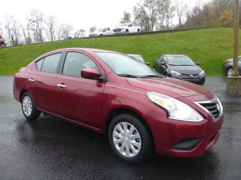 Cayenne Red Nissan Versa SL.  Click to enlarge.