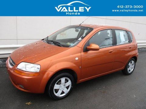 Spicy Orange Chevrolet Aveo 5 LS Hatchback.  Click to enlarge.