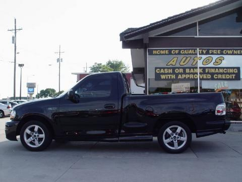 Black 2002 Ford F150 SVT Lightning with SVT Medium Graphite interior Black