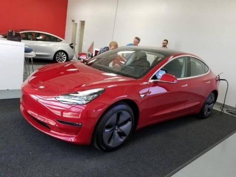 Red Multi-Coat Tesla Model 3 Long Range.  Click to enlarge.