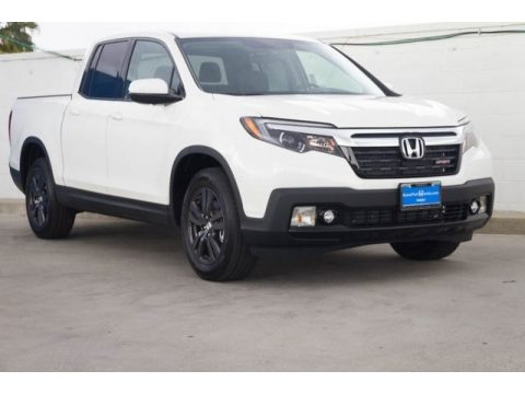 White Diamond Pearl Honda Ridgeline Sport.  Click to enlarge.