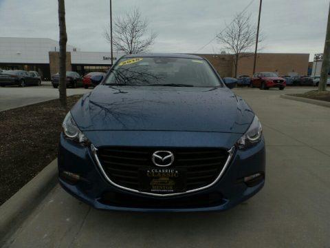 Eternal Blue Mica Mazda MAZDA3 Touring 4 Door.  Click to enlarge.