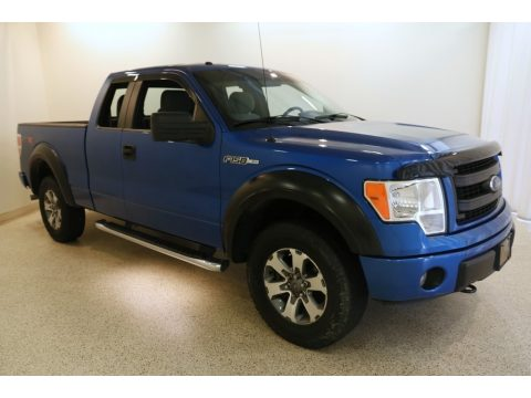 Blue Flame Metallic Ford F150 STX SuperCab 4x4.  Click to enlarge.