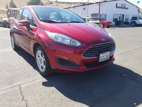 Ruby Red Metallic Ford Fiesta SE Sedan.  Click to enlarge.