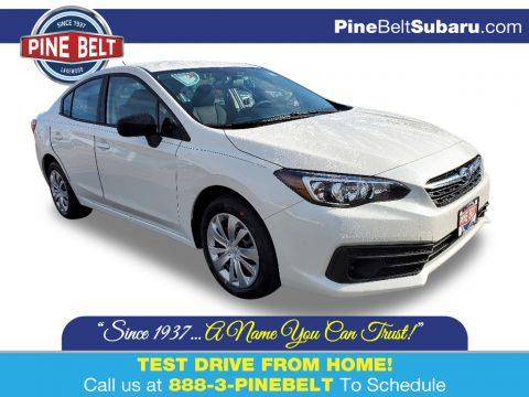 Crystal White Pearl Subaru Impreza Sedan.  Click to enlarge.