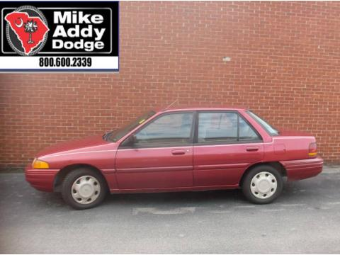 Electric Current Red Metallic Ford Escort LX Sedan.  Click to enlarge.