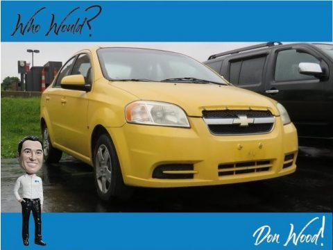 Summer Yellow Chevrolet Aveo LT Sedan.  Click to enlarge.
