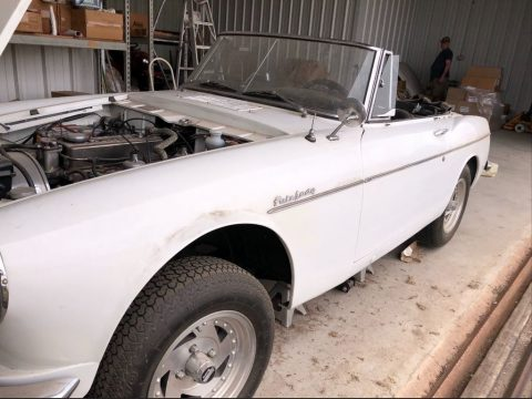 White Datsun 1600 Convertible.  Click to enlarge.