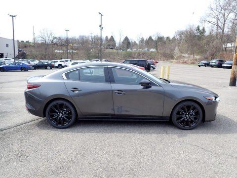 Machine Gray Metallic Mazda Mazda3 Premium Plus Sedan AWD.  Click to enlarge.