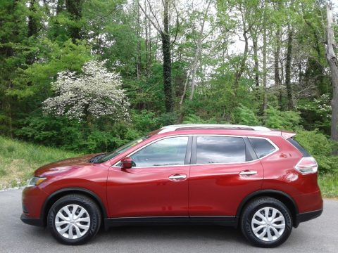 Cayenne Red Nissan Rogue S.  Click to enlarge.