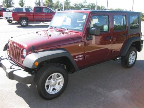 Red Rock Crystal Pearl 2010 Jeep Wrangler Unlimited Sport 4x4 with Dark