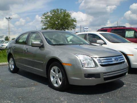 Vapor Silver Metallic 2009 Ford Fusion SE with Medium Light Stone interior