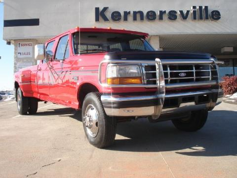 Ultra Red Ford F350 XLT Crew Cab 4x4 Dually.  Click to enlarge.