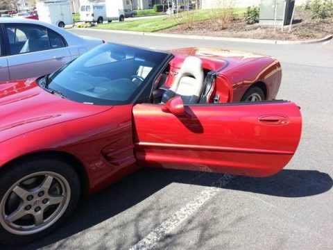 Magnetic Red Metallic Chevrolet Corvette Convertible.  Click to enlarge.
